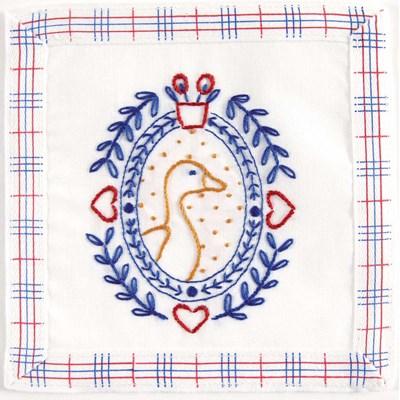 Kit broderie imprimée l'oie aux coeurs rouges - normandie - DMC