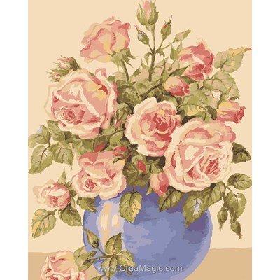 Collection d'art canevas roses dans un vase bleu