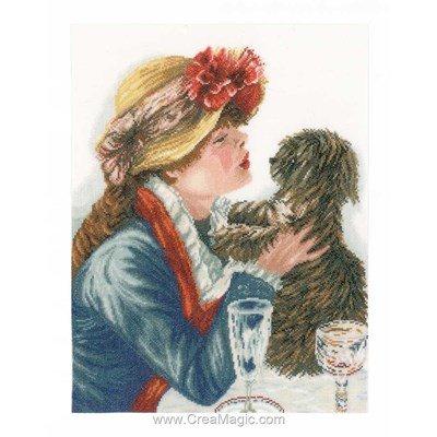 Modèle broderie au point de croix complicité fille au chapeau et son chien de Lanarte